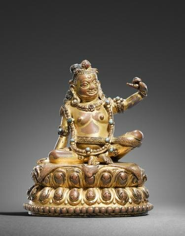 A gilt copper alloy figure of Virupa, Tibet or Nepal, 14th century