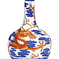 A magnificent and extremely rare iron-red and underglaze-blue 'dragon' bottle vase, seal mark and period of qianlong (1736-1795