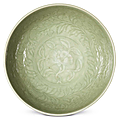 A carved longquan celadon 'floral' bowl, yongle-xuande period (1403-1435)