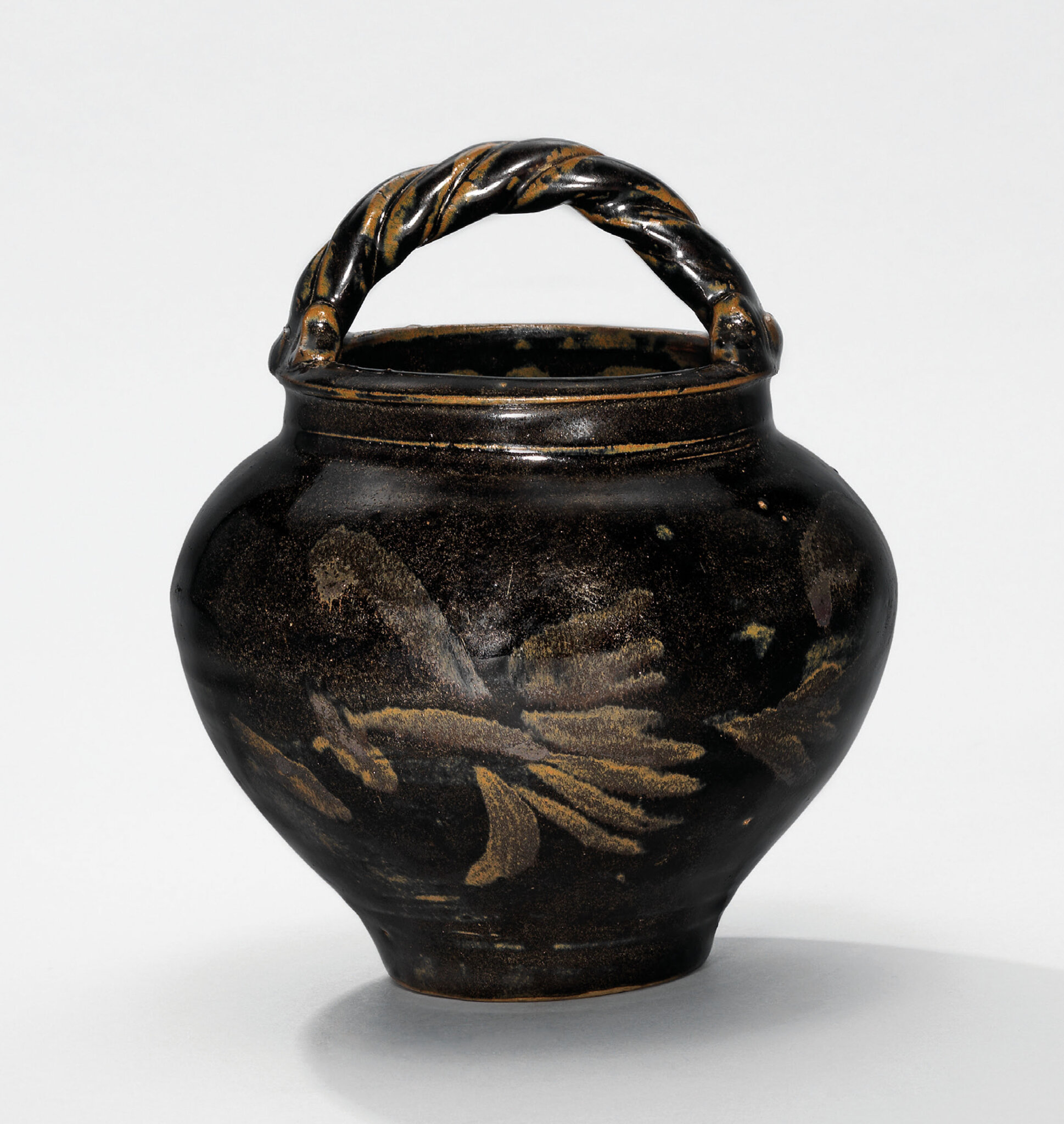 A russet-painted blackishbrown-glazed jar with rope-twist handle, Northern Song-Jin dynasty (960-1234)