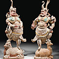 A rare large pair of painted and gilded pottery figures of lokapalas, Tang dynasty (618-907)