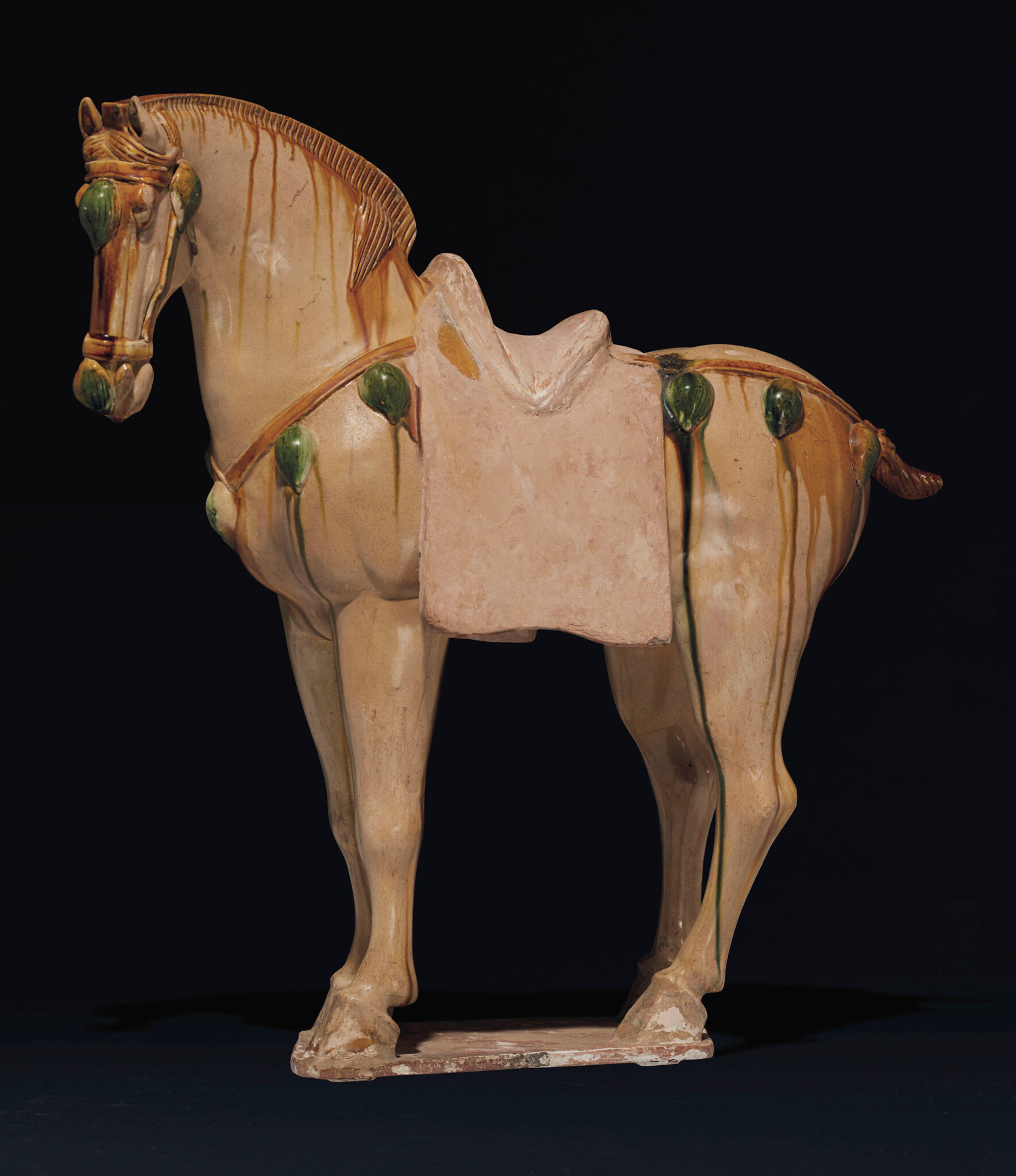 A large sancai-glazed pottery figure of a horse, Tang dynasty (AD 618-907)