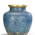 A rare and large imperial archaistic gilt-bronze and cloisonné enamel vase, zun, qianlong period