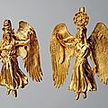 Earrings with nike, goddess of victory greek. mid 4th century bc.
