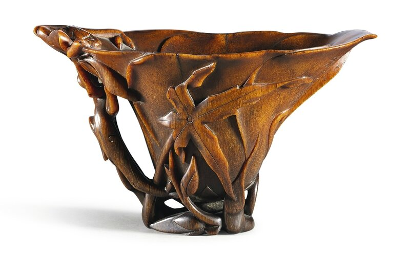 A rare, superbly carved and inscribed rhinoceros horn 'chilong' libation cup, Ming dynasty, dated renwu year of the Wanli period (in accordance with 1582)