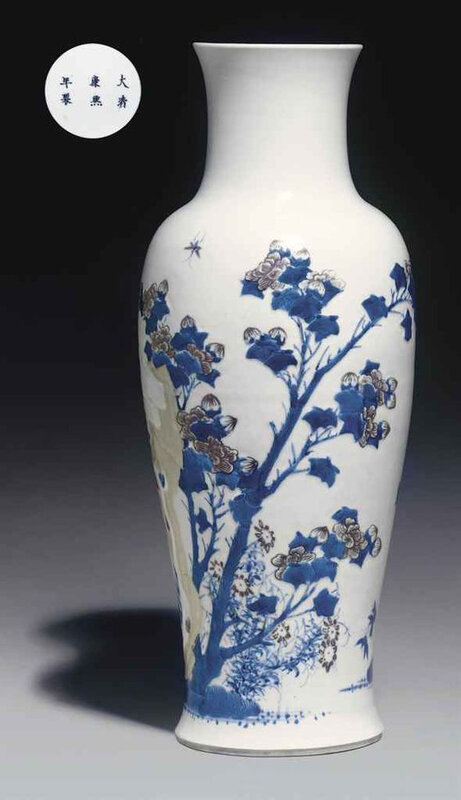 A copper-red and celadon-decorated blue and white carved baluster vase, Kangxi six-character mark in underglaze blue within a double circle and of the period (1662-1722)