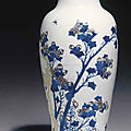 A copper-red and celadon-decorated blue and white carved baluster vase, kangxi six-character mark and of the period (1662-1722)
