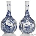 A pair of blue and white fabulous animal and antiques bottle vases, China, Kangxi period
