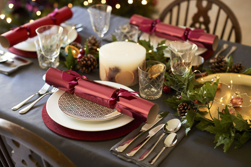 close-up-of-christmas-table-setting-with-christmas-royalty-free-image-1571173961