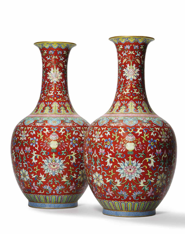 A rare pair of coral-red groundfamille rosevases, Jiaqing six-character seal mark in iron-red and of the period (1796-1820)