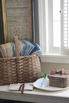 Nature's Basket fabrics and an antique sampler in the frame