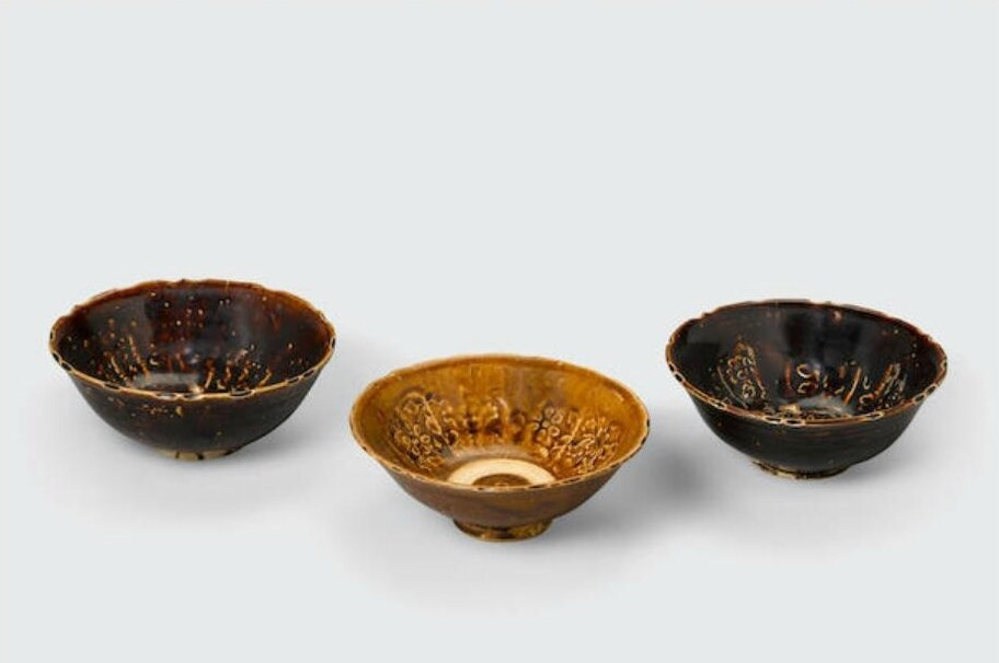 A group of three brown glazed bowls with impressed decoration, Trần-Lê dynasty, 14th-15th century