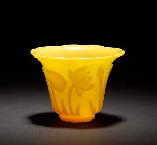 An Imperial-yellow monochrome Peking glass cup, 19th century. photo Bonhams.