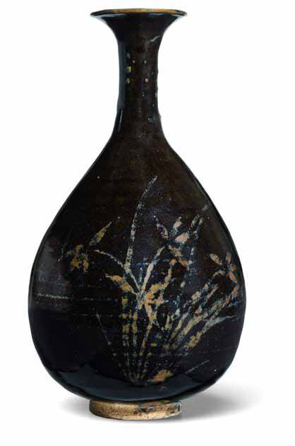 A 'Henan' black-glazed and russet-painted bottle vase, Jin dynasty (1115-1234)