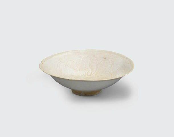 A cream glazed bowl with carved decoration, Lý–Trần dynasties, 12th-13th century