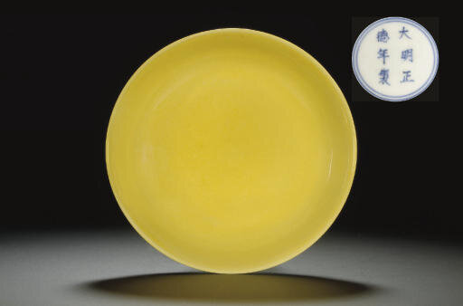 An Imperial yellow-glazed dish, Zhengde six-character mark in underglaze blue within a double circle and of the period (1506-1521)