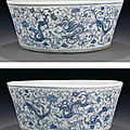 An unusual large blue and white 'dragon and phoenix' jardinière, 18th century