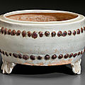A_Qingbai_iron_brown_decorated_drum_form_tripod_censer__China__Yuan_dynasty__1279_1368_