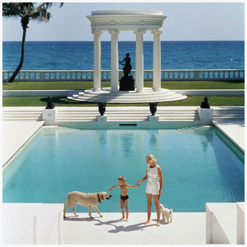 mrs-f-c-winston-guest-aka-cee-zee-guest-and-her-son-alexander-michael-douglas-dudley-guest-in-front-of-their-grecian-temple-villa-artemis-palm-beach-photo-slim-arons-1955