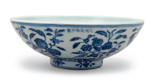 Porcelain bowl with underglaze blue fower and fruit sprays around sides, Xuande mark and period