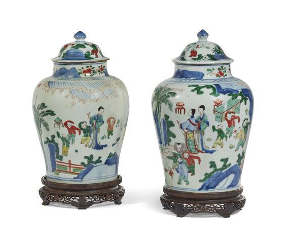 A pair of wucai 'Ladies and boys' jars and covers, Transitional period, 17th century