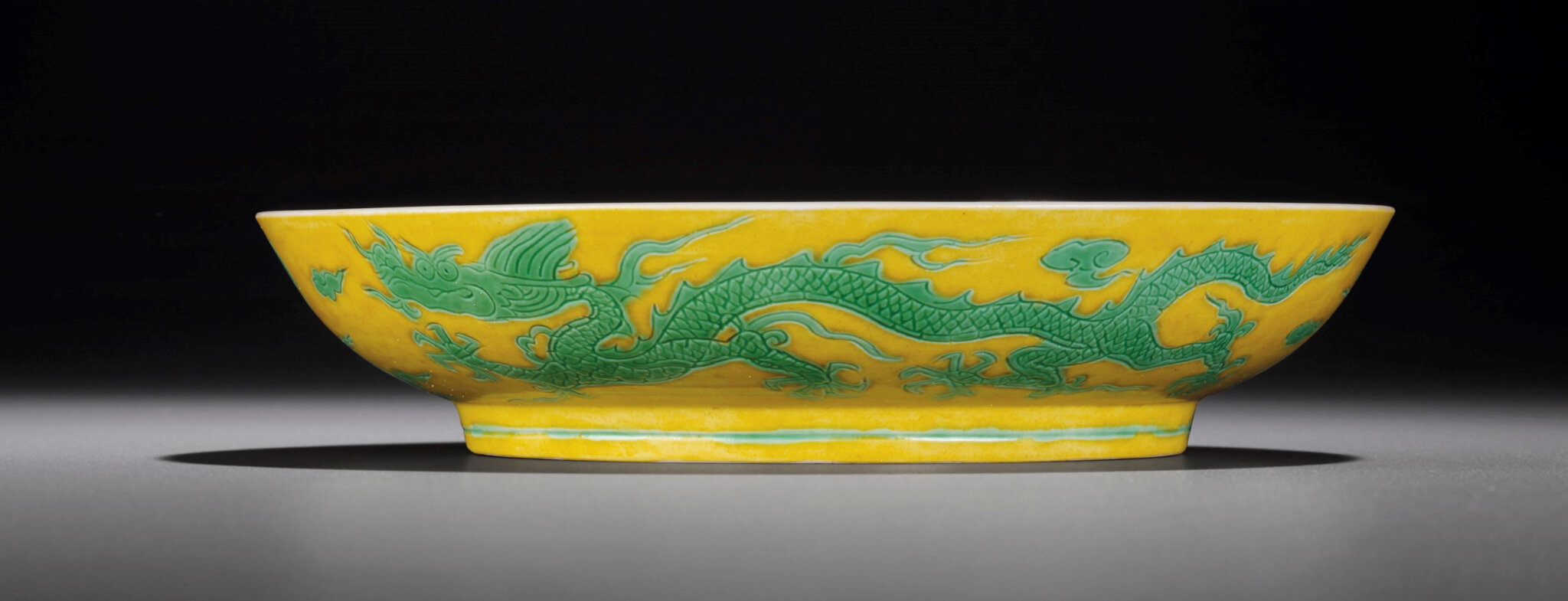 A yellow-ground green-enamelled 'Dragon' dish, Zhengde four-character mark within double-circles and of the period (1506-1521) (3)