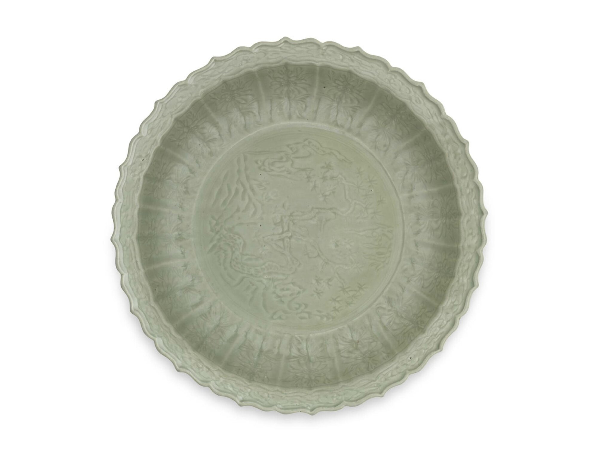 A large Longquan celadon-glazed carved barbed-rim dish, Early 15th century