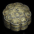 A small parcel-gilt silver lobed circular box and cover, tang dynasty (618-907)