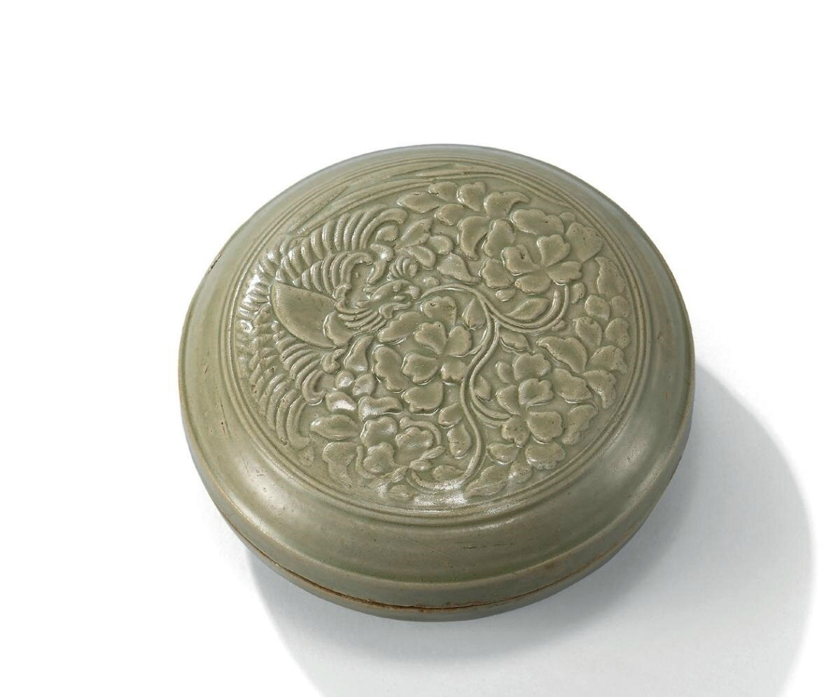 A rare carved yue 'parrot and peony' circular box and cover, Northern Song dynasty (960-1127)