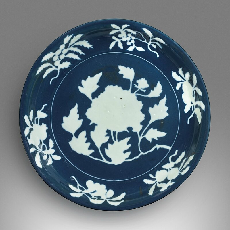 An exceptionally rare and large fine blue and white reserve-decorated 'peony' dish, Xuande mark and period (1426–1435)