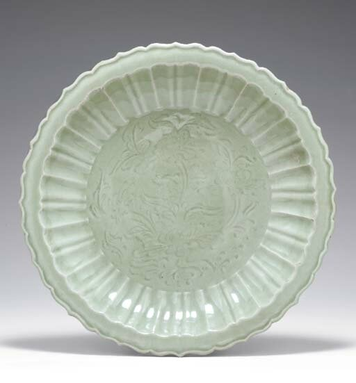 A large carved Longquan celadon barbed dish, Yuan dynasty, 14th century
