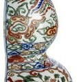 A very rare Impérial wucai double-gourd wall vase, China, underglaze blue Wanli mark and period