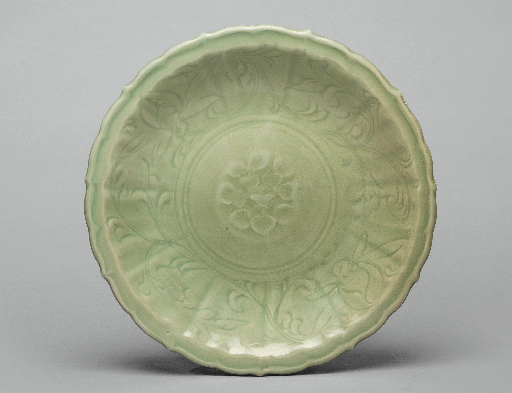 A 'Longquan' celadon barbed-rim 'floral' dish, Ming dynasty