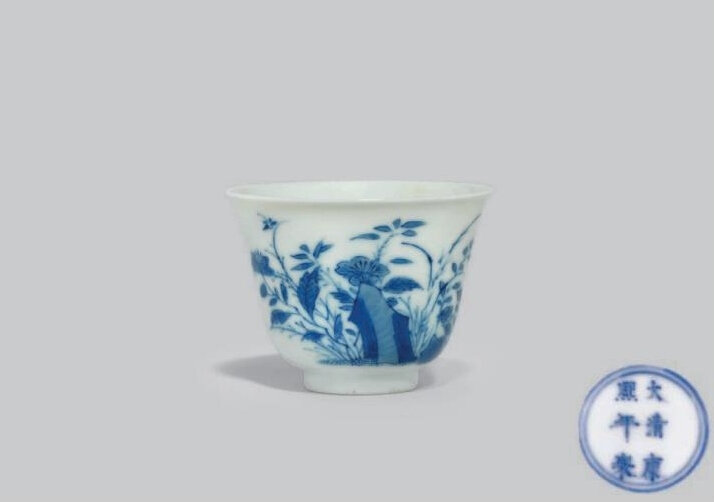 A blue and white wine cup, Kangxi six-character mark in underglaze blue within a double circle and of the period (1662-1722)