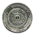 A silvery bronze 'TLV' circular mirror, Eastern Han dynasty (AD 25-220)