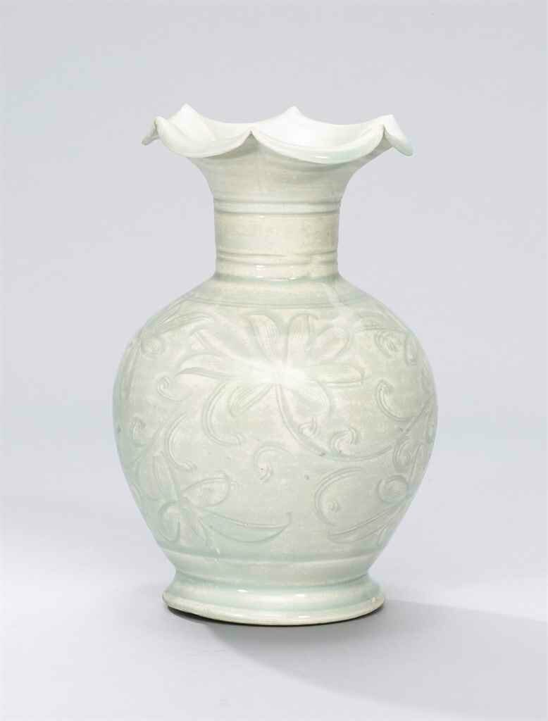 A carved Qingbai 'daylily' vase, Northern Song dynasty (960-1127)