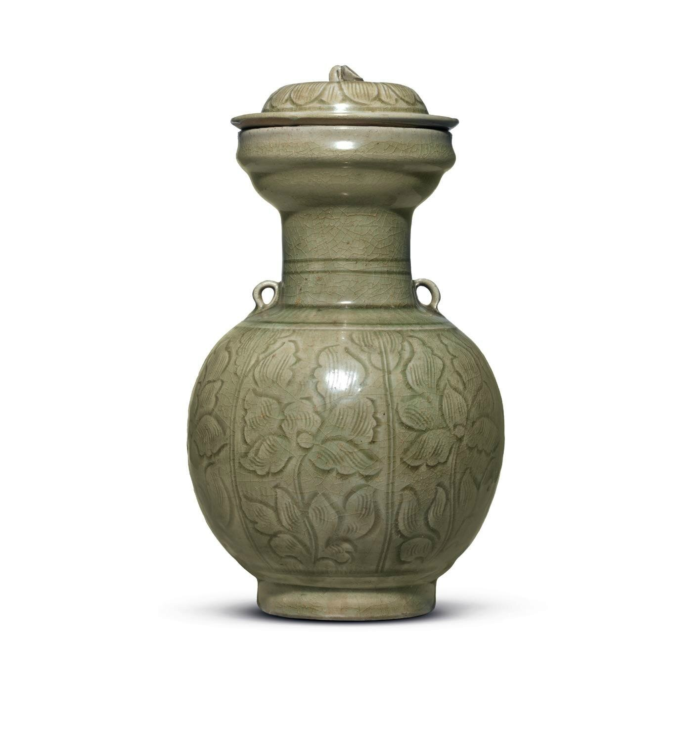 A rare carved Longquan celadon vase and cover, Northern Song dynasty, 11th-12th century