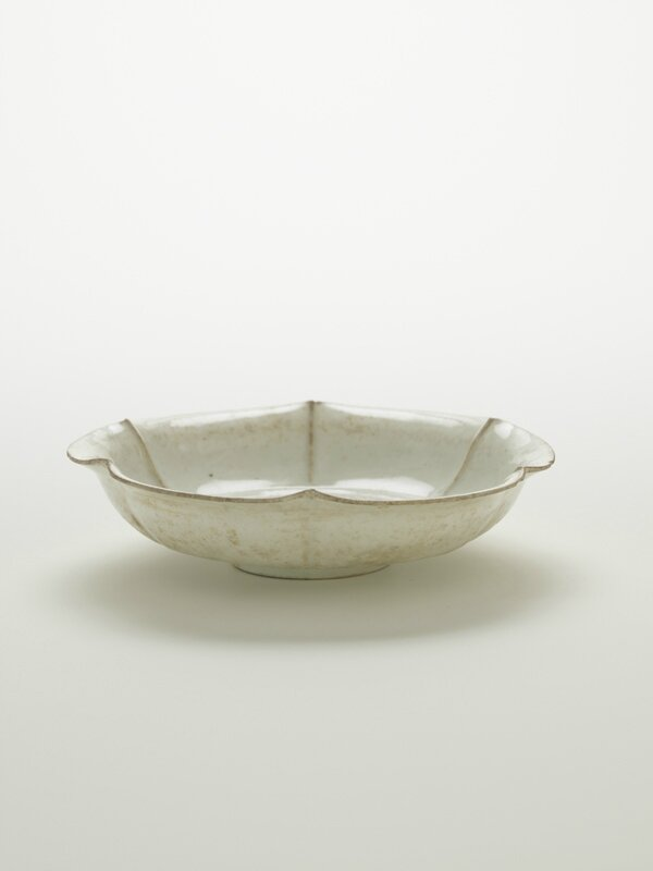 Dish with six-lobed rim, 11th-early 12th century, Northern Song dynasty,Porcelain with transparent pale-blue (qingbai) glaze, H: 4.3 W: 16.4 cm, China. Gift of Charles Lang Freer, F1917.14a-b. Freer/Sackler © 2014 Smithsonian Institution