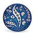 A rimless iznik pottery dish, ottoman turkey, circa 1575