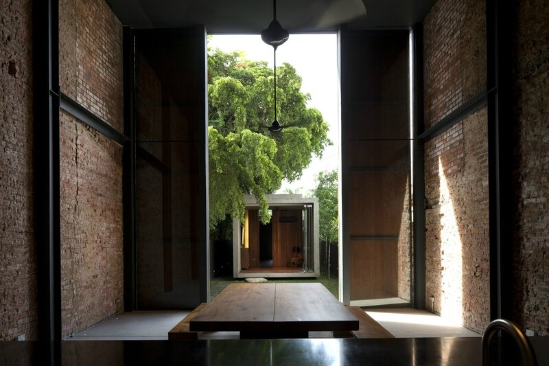 When_the_sliding_door_panels_open_-_a_framed_view_of_the_Rear_House_from_the_Kitchen_Dining_area_Albert_Lim_K_S