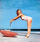 1949_tobey_beach_by_dedienes_umbrella_red_061_1
