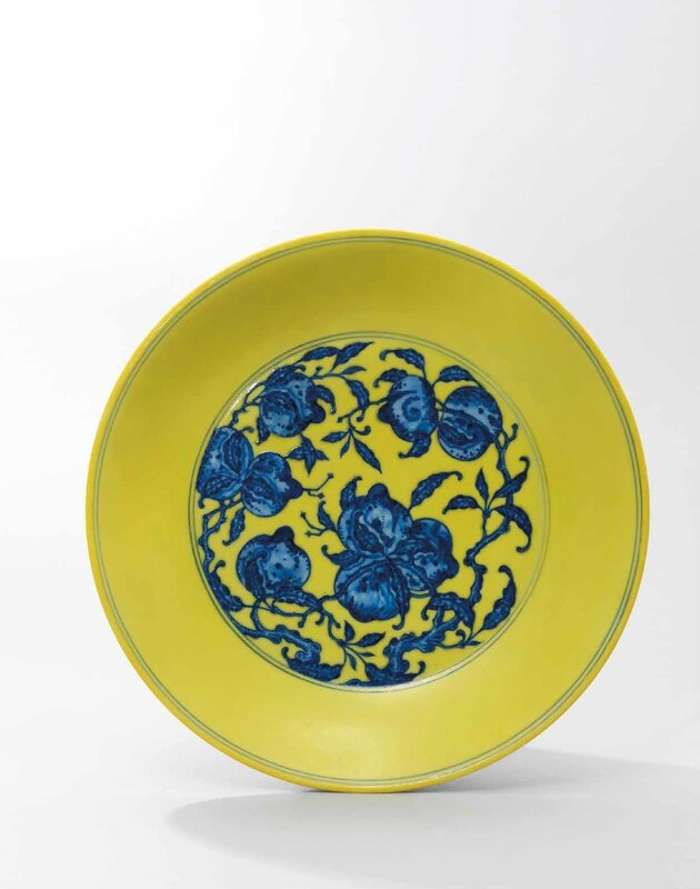 A fine large yellow-ground blue and white 'nine peaches' dish, Qianlong six-character seal mark in underglaze blue and of the period (1736-1795)