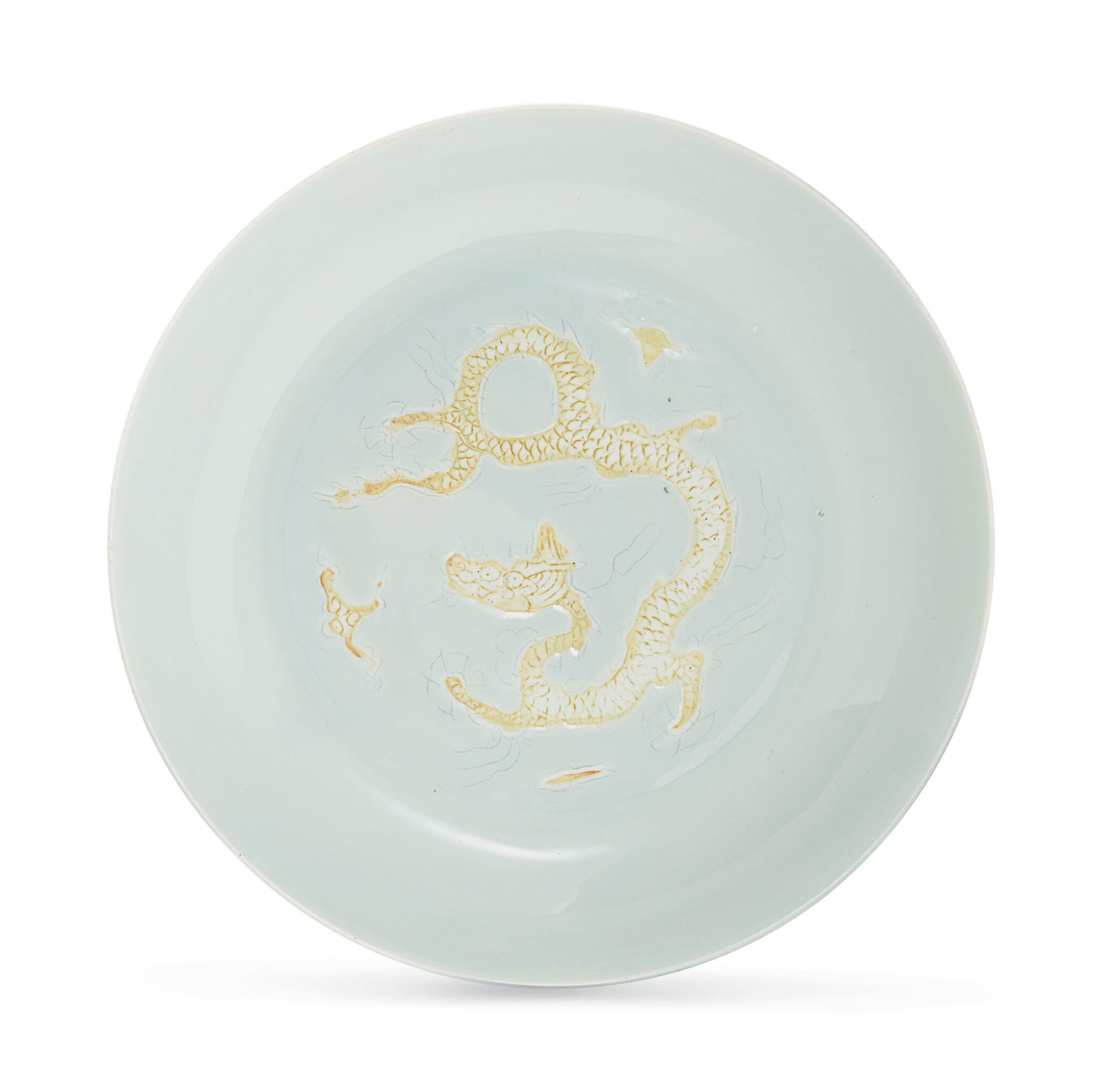 A rare white-glazed biscuit-decorated 'dragon' dish,Hongzhi six-character mark in underglaze blue within a double circle and of the period (1488-1505)