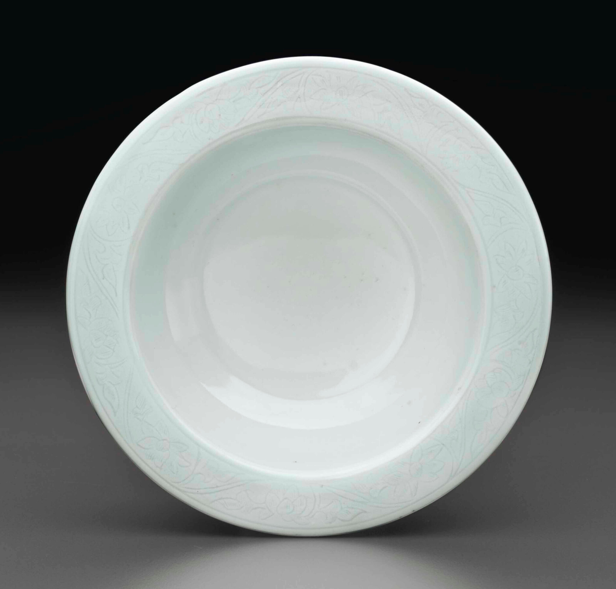 A rare small white-glazed incised dish, Ming dynasty, 15th century