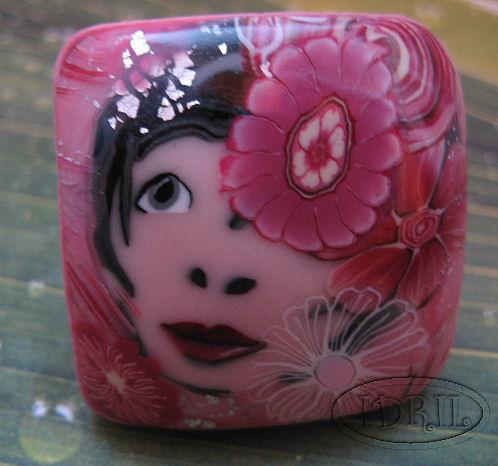 bague rose face idril