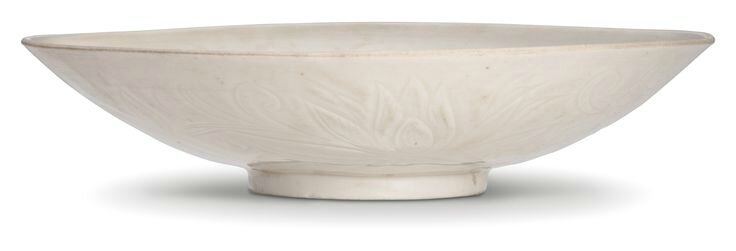A carved 'Ding' 'lotus' bowl, Northern Song-Jin dynasty
